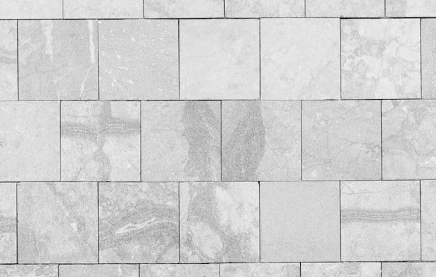 Superfície do fundo de parede de tijolo de mármore branco vintage.