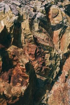 Superfície do mármore com tonalidade marrom textura de pedras e fundo