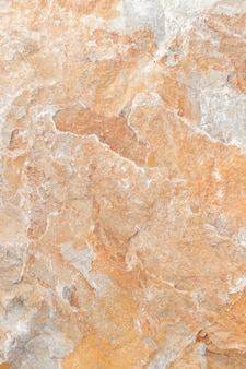 Superfície do mármore com tonalidade marrom, textura e fundo de pedra.