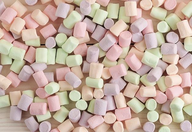 Superfície dos marshmallows doces espalhados