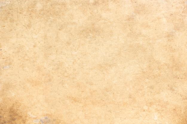 Superfície e vestígios de folhas de papel antigas.