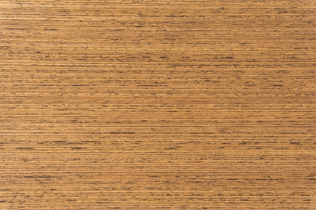 Superfície natural de madeira amarela do fundo e da textura.