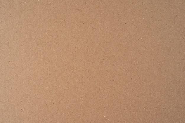 Superfície sem emenda de fundo de textura de caixa de papelão reciclado marrom para uso de design em alta resolução e textura visível, espaço de cópia, disposição plana