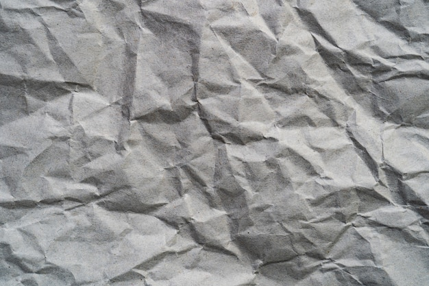 Superfície velha do grunge do fundo da textura do papel marrom. em branco para o espaço da cópia do texto.