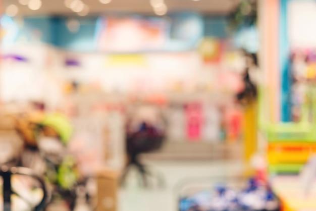 Supermercado turva fundo abstrato. fundo desfocado de loja de loja de departamento de criança. fundo de loja de bebê com bokhe.