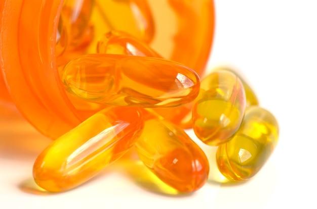 Suplemento dietético na cápsula de gelatina mole.