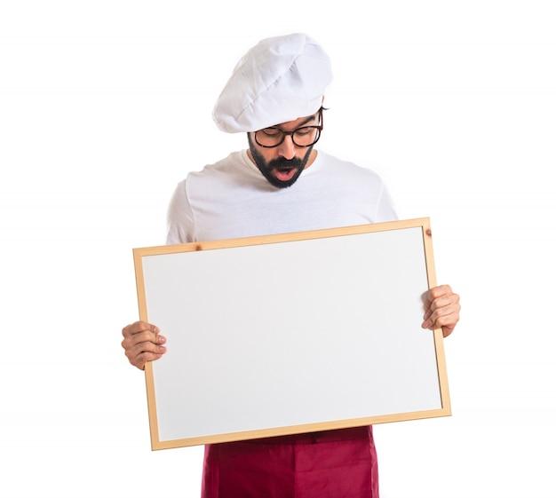 Surpreendido, cozinheiro, segurando, vazio, placard