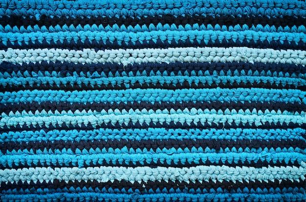 T-shirts de algodão, textura artesanal de tapete listrado ciano azul marinho.