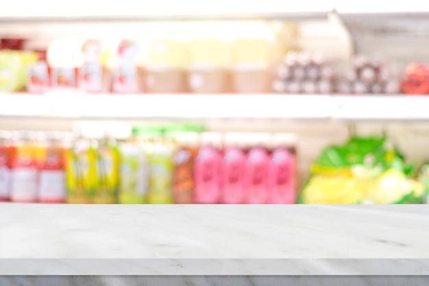 Tabela de cimento branco vazio sobre a prateleira de produto borrão no supermercado supermercado no centro comercial b