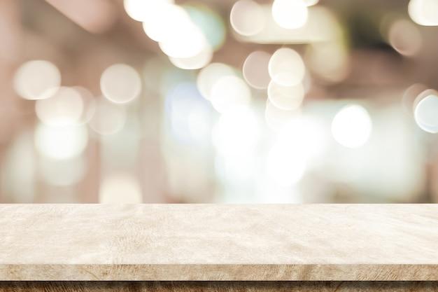 Tabela de cimento marrom vazio sobre fundo de loja de desfoque, montagem de exposição de produto
