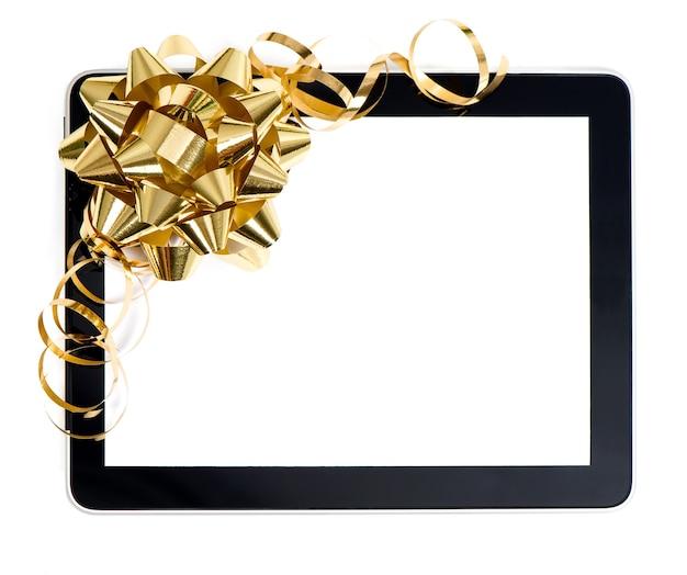 Tablet pc com decoração de laço e fita dourada. conceito de presente