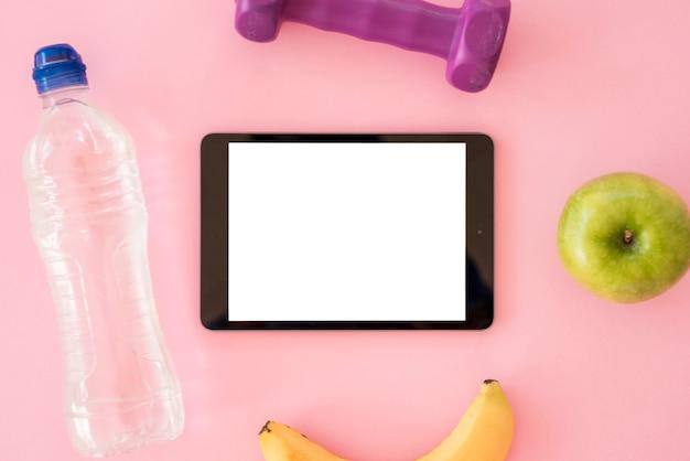Tablet vista superior com coisas saudáveis