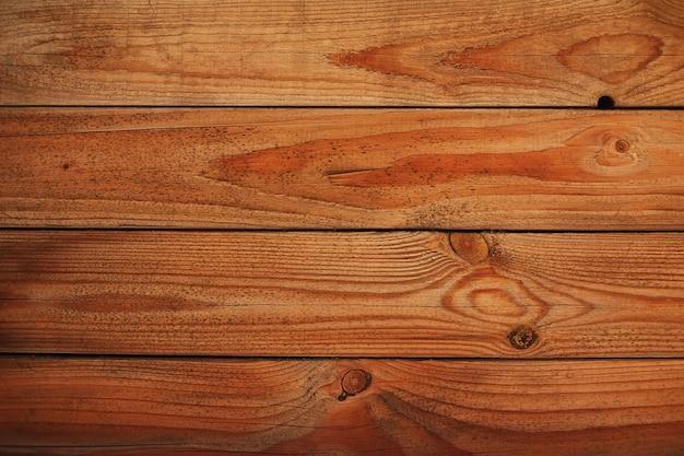 Tábuas de madeira de textura de fundo cor marrom iluminação natural ao ar livre