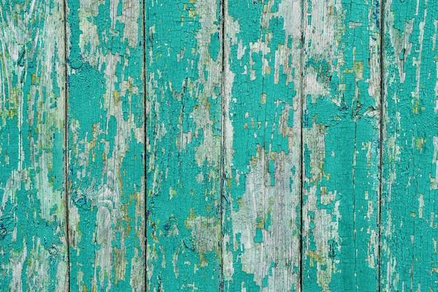 Tábuas de madeira pintadas de azul como plano de fundo ou textura, padrão natural