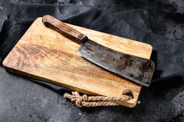 Talhador de carne açougueiro vintage na placa de concreto ... copie o espaço