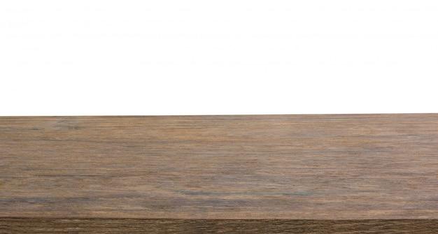 Tampo da mesa de madeira escura vazio isolado no fundo branco com traçado de recorte e copyspace para exibição ou montagem de seus produtos