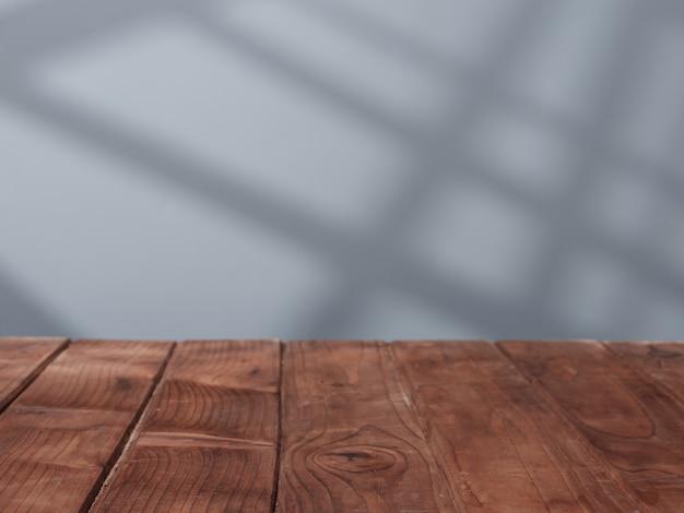 Tampo da mesa de madeira vazio com luz da janela