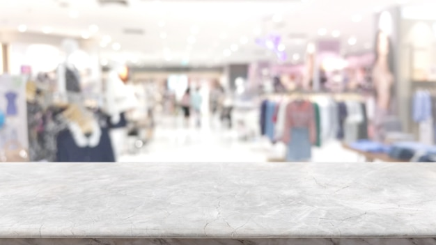 Tampo da mesa de mármore de pedra branca vazia e interior abstrato borrado de fundo de shopping.