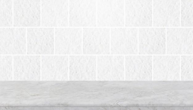 Tampo da mesa e fundo de pedra brancos vazios da parede cinzenta da telha da pedra do granito.