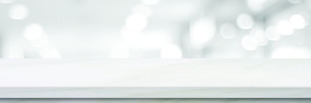 Tampo de mesa branco vazio, balcão, mesa sobre loja de perspectiva desfocada com fundo claro bokeh