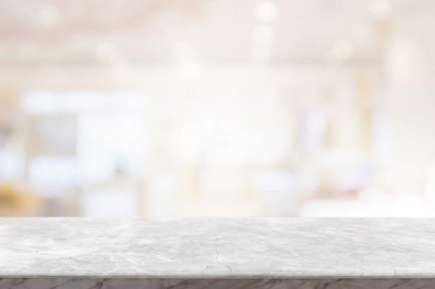 Tampo de pedra de mármore branco vazio no borrão bokeh café e interior restaurent