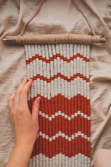 Tapeçaria de macramê artesanal