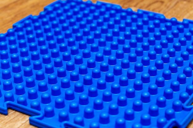 Tapetes ortopédicos de massagem coloridos close-up