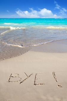 Tchau feitiço escrito na areia da praia tropical caribe