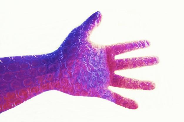 Technicolor mão no envoltório de bolha