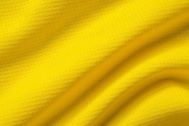 Tecido amarelo para roupas esportivas, camisa de futebol, textura de jersey close-up