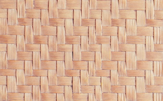 Tecido artesanal de estilo tailandês tradicional. textura de rattan para o fundo