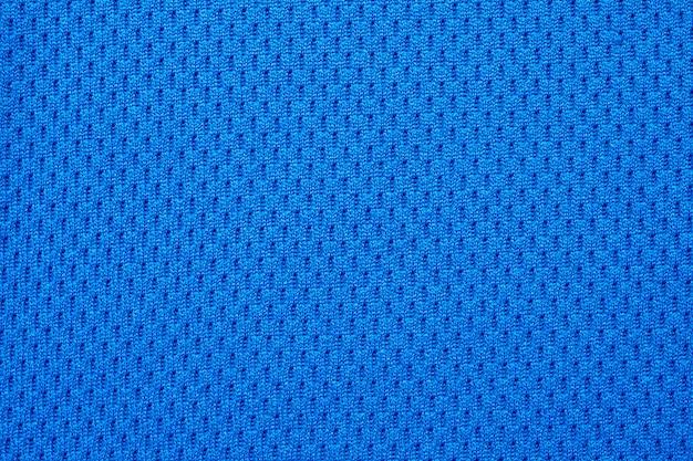 Tecido azul para roupas esportivas, camisa de futebol, textura de jersey close-up