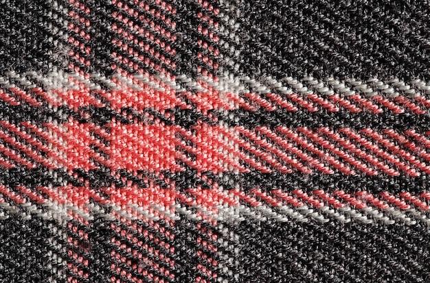 Tecido com padrão xadrez vermelho, estrutura de fundo, visão macro close-up