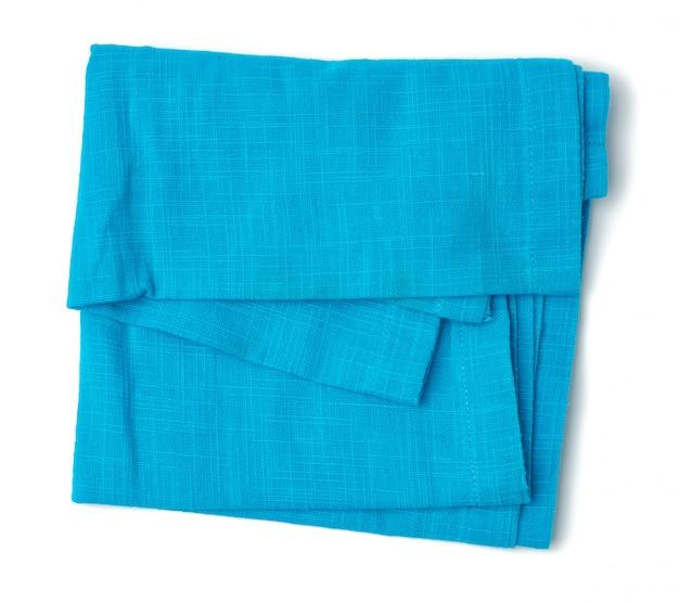 Tecido de algodão azul dobrado isolado no fundo branco