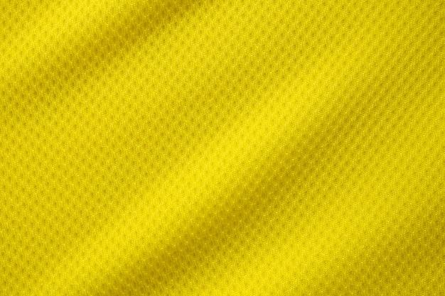 Tecido de camisa de futebol de cor amarela, textura de tecido, esportes, fundo, close-up