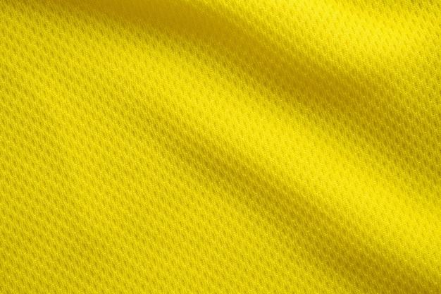 Tecido de camisa de futebol de cor amarela, textura de tecido, esportes, plano de fundo, close-up
