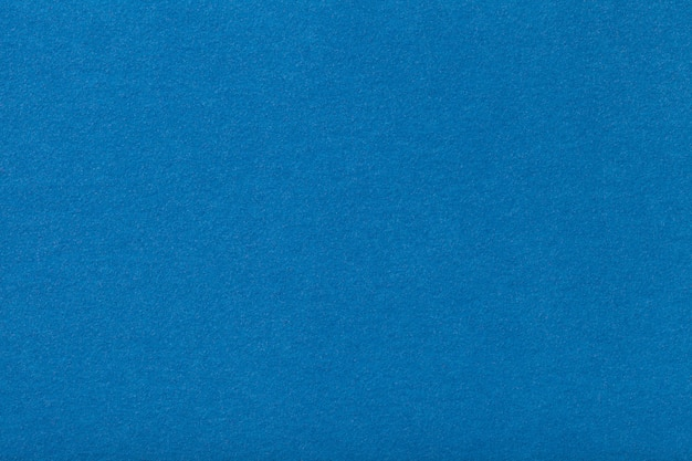 Tecido de camurça mate azul claro. textura de veludo de fundo de feltro