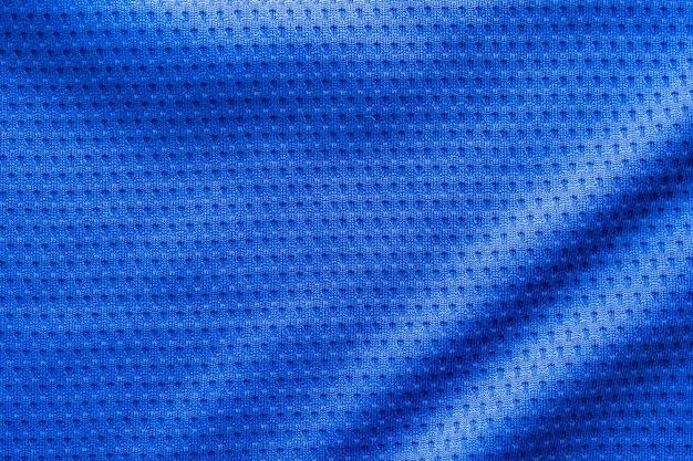 Tecido de cor azul, roupas esportivas, camisa de futebol com fundo de textura de malha de ar
