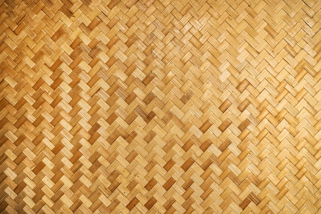 Tecido de fundo de madeira. parede de bambu tecido amarelo