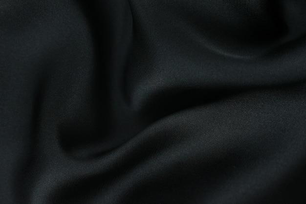 Tecido de fundo. tecido têxtil escuro com textura e fundo de cortina padrão