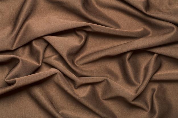 Tecido de fundo. tecido têxtil marrom com textura