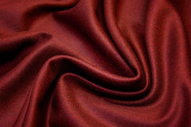 Tecido de lã vermelha com ondas