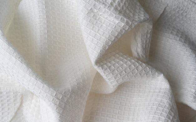 Tecido de linho natural waffle de algodão orgânico cru. guardanapo branco texturizado