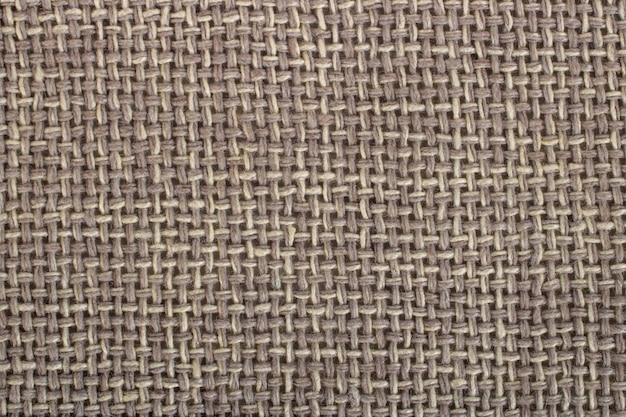 Tecido de lona marrom com textura como fundo