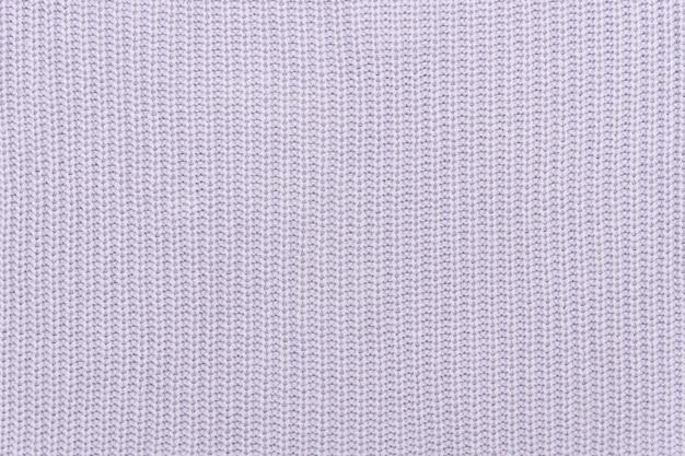 Tecido de malha lilás. textura sem costura