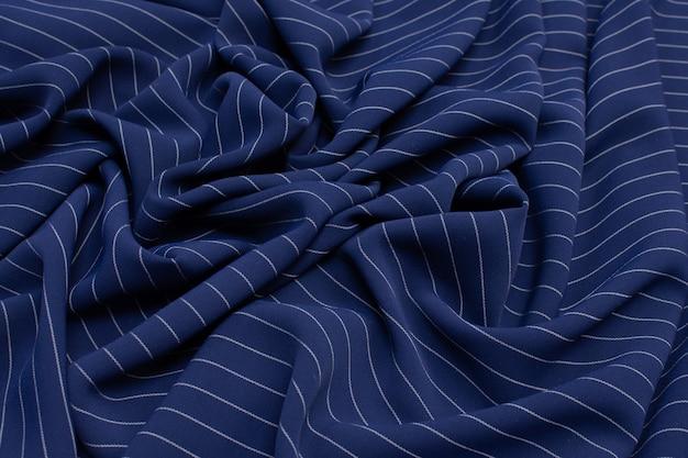 Tecido de poliamida. a cor é uma faixa azul e branca. textura,