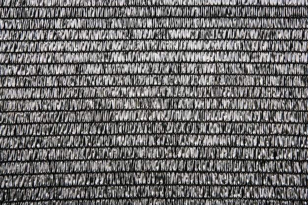 Tecido de ráfia cinza textura de fundo de padrão plástico