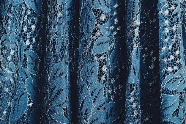 Tecido de renda azul com padrão floral