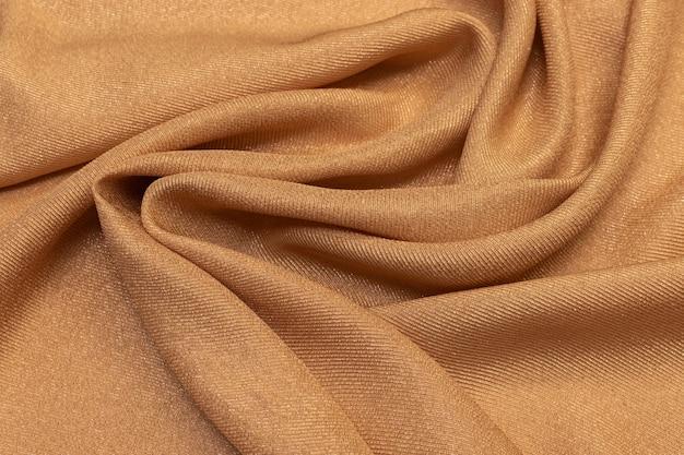 Tecido de seda chiffon com lurex de areia em formato artístico. textura,