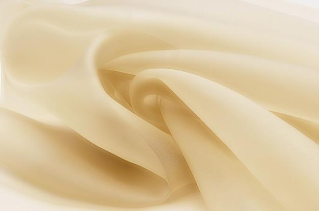 Tecido de seda, organza bege.